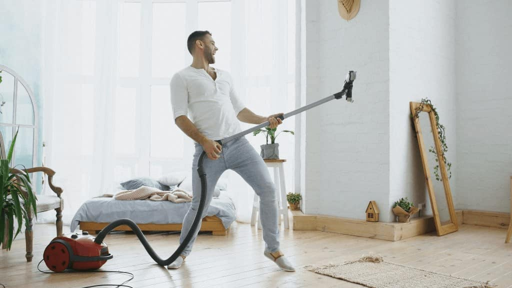 Man playing with wet vac