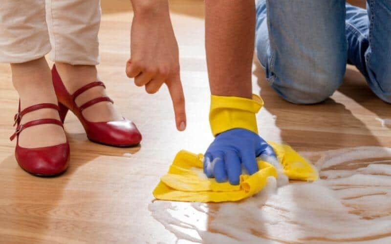 man and woman cleaning floor
