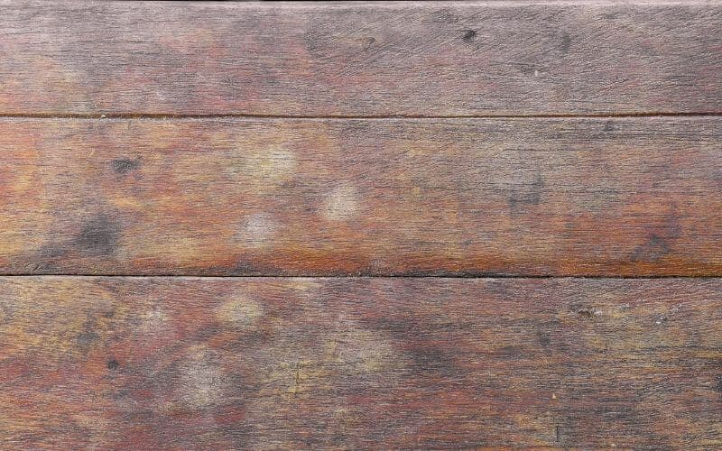 old wood stained with water